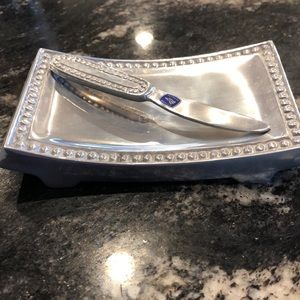 Silver colored butter dish and butter knife